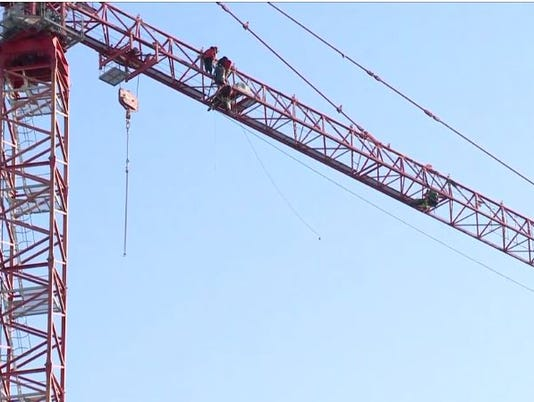 Greenpeace protesters climb crane in northwest DC