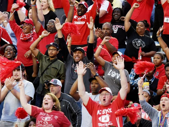 NC State fans cheer as their team make a touchdown