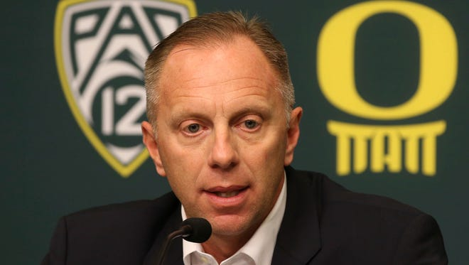In this Nov. 29, 2016, file photo, Oregon athletic director Rob Mullens talks to the media in Eugene, Ore., after the firing NCAA college football head coach Mark Helfrich. Mullens will become the new chairman of the College Football Playoff selection committee starting next season, and three new Power Five ADs will join the 13-member panel.