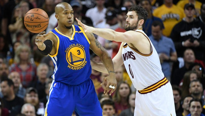 Jun 9, 2017; Cleveland, OH, USA; Golden State Warriors forward David West (3) passes the ball away from Cleveland Cavaliers forward Kevin Love (0) during the second half in game four of the 2017 NBA Finals at Quicken Loans Arena.