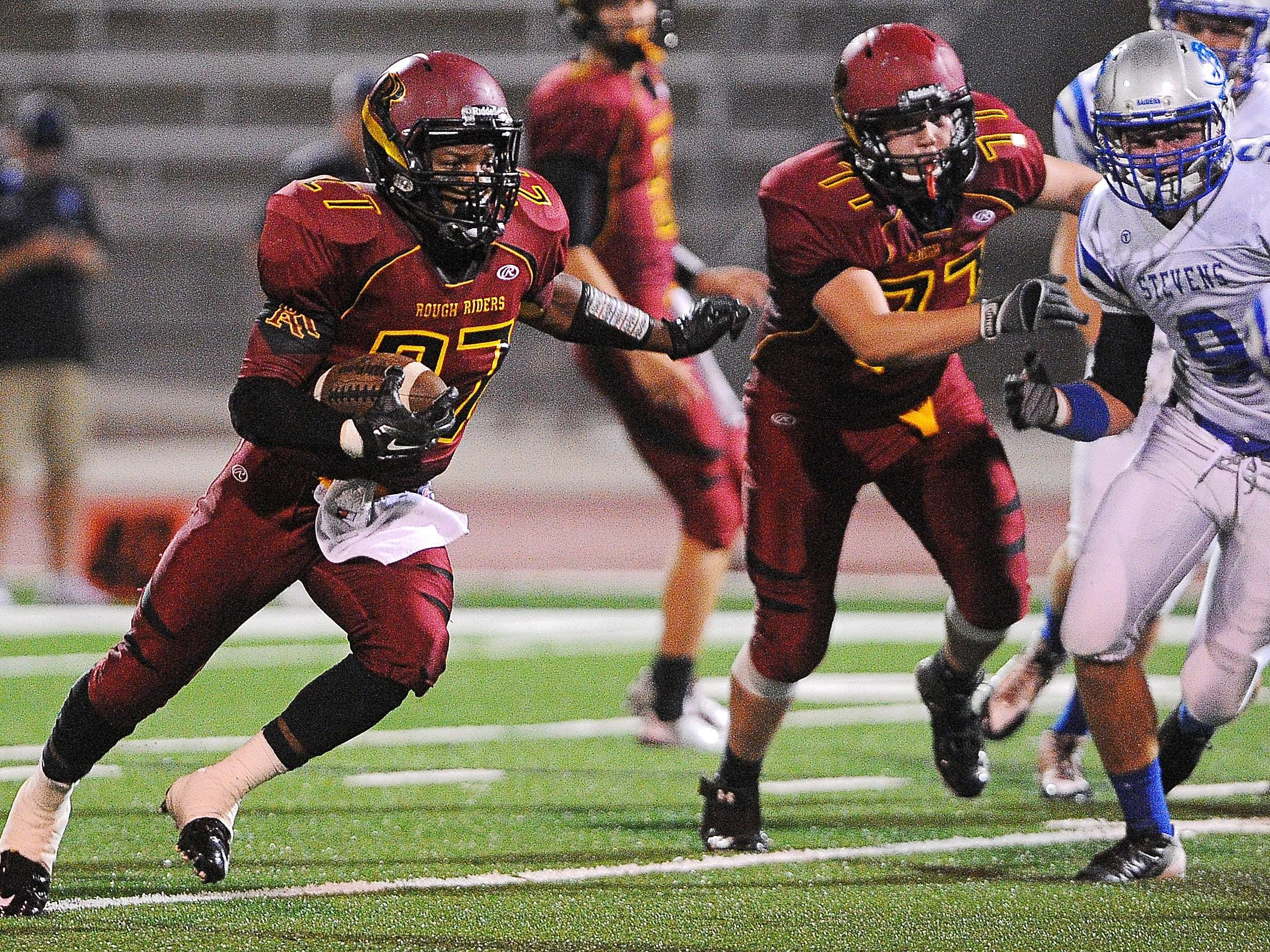 Roosevelt's Tyson Jahn looks for a hole as he carries the ball during a game against Rapid City Stevens.