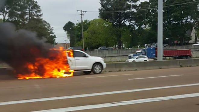 An SUV burns on I-55 in Jackson Tuesday.
