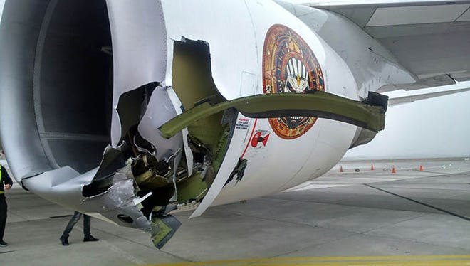 This photo offers a close-up look at the engine damage caused to Iron Maiden's plane when a towing mechanism broke on the way to a fueling stop.