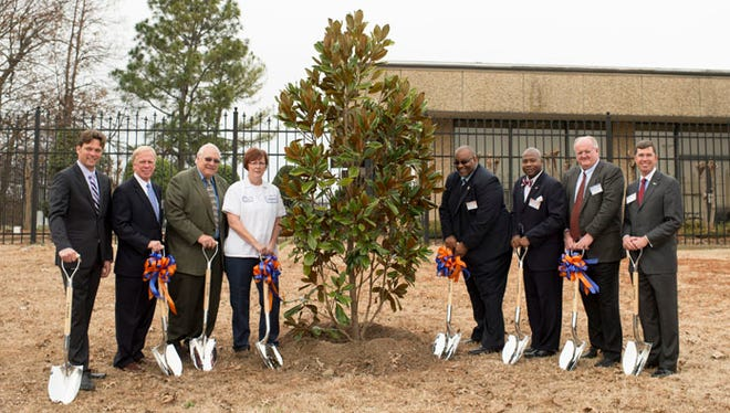"To commemorate the 35th anniversary of the Mars Food Plant in Greenville, Mississippi in 2013, elected officials and associates planted a Southern Magnolia tree at the factory in the ""Magnolia State."" From left: Michael Robbers, Mars Food Vice President of Supply; Greenville Mayor John H. Cox III; Paul Watson, Jr., President, Washington County Board of Supervisors; Sherry Day, Plant Director, Mars Food; State Representative John Hines; State Senator Derrick Simmons; Frank Mars, Mars, Incorporated Board member; and Brent Christensen,"