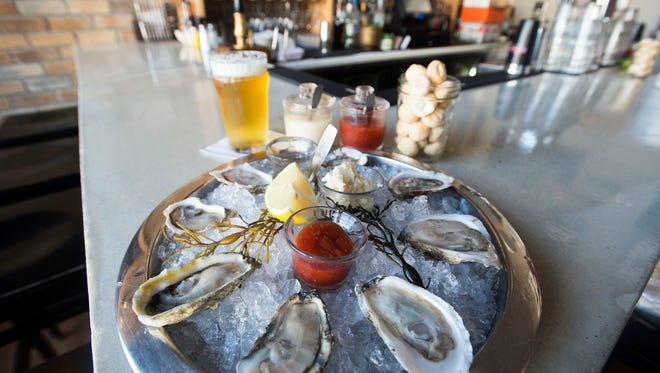 An sampler from Henlopen City Oyster House in Rehoboth Beach featuring oysters oysters from across the country including Virgina, Massachusetts and Canada.