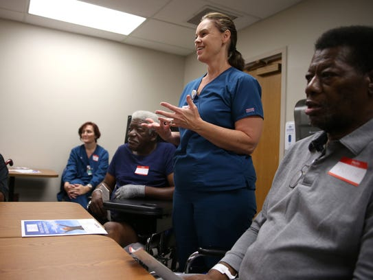 Speech therapist Tanya Stokes speaks to patients at
