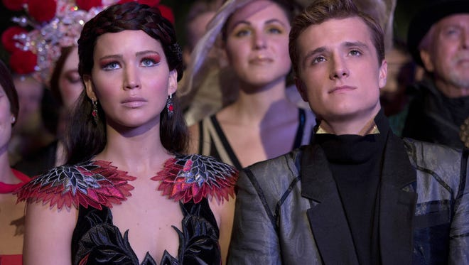 Jennifer Lawrence and Josh Hutcherson in the motion picture 'The Hunger Games: Catching Fire.'