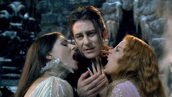 Dracula (Richard Roxburgh) hangs with his vampire brides