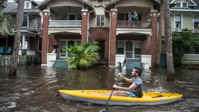 JACKSONVILLE, FL - SEPTEMBER 11: Justin Hand navigates storm surge flood waters from Hurricane Irma along the St. Johns River on Sept. 11, 2017 in Jacksonville, Florida. Flooding in downtown Jacksonville along the river topped a record set during Hurricane Dora in 1965.