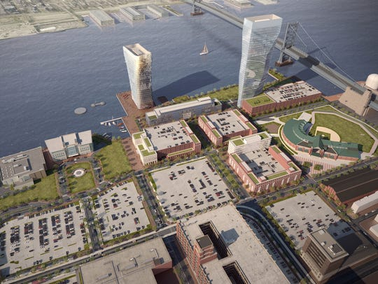 A rendering shows an aerial view of the proposed development