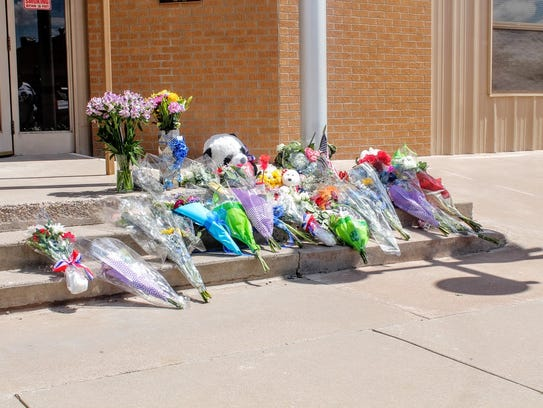 A makeshift memorial was set up outside the Alamogordo