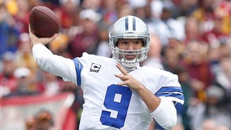 Dallas Cowboys quarterback Tony Romo (9) throws the ball against the Washington Redskins in the first quarter at FedEx Field.