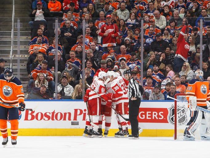 Detroit Red Wings celebrate a goal as Edmonton Oilers'