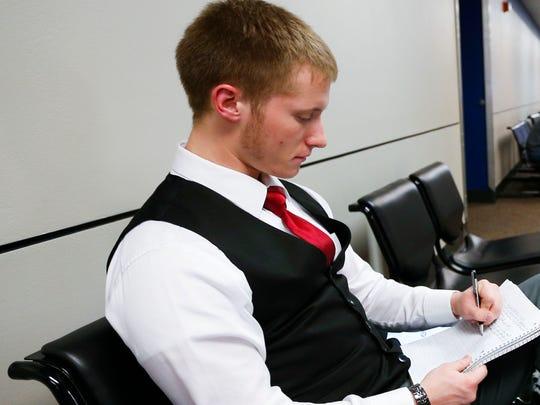 Joshua Jones studies in the Norman K. Myers building