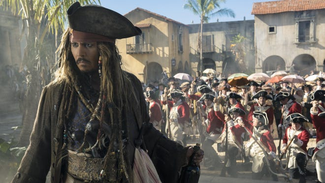 """Johnny Depp is back as Jack Sparrow in a meandering tale about a quest to find the trident of Poseidon in """"Pirates of the Caribbean: Dead men Tell No Tales."""""""