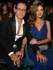 Recording artist Marc Anthony (L) and model Shannon