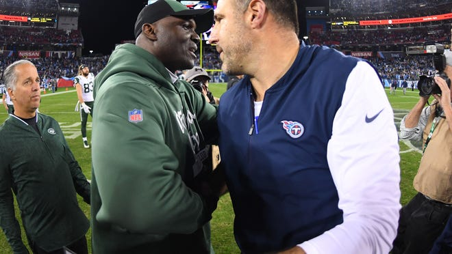 Dec 2, 2018; Nashville, TN, USA; New York Jets head coach Todd Bowles and Tennessee Titans head coach Mike Vrabel after a Titans win at Nissan Stadium. Mandatory Credit: Christopher Hanewinckel-USA TODAY Sports