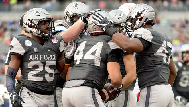 Dec 30, 2016: Air Force Falcons linebacker Grant Ross (44) is congratulated after recovering a fumble from the South Alabama Jaguars during the second quarter of the Arizona Bowl at Arizona Stadium.
