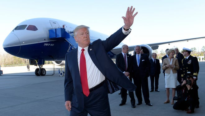 President Donald Trump waves in front of the Boeing 787 Dreamliner while visiting the Boeing South Carolina facility in North Charleston, S.C., Friday, Feb. 17, 2017. Trump is visiting Boeing before heading to his Mar-a-Lago estate in Palm Beach, Fla., for the weekend.