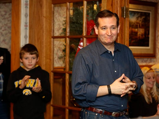 Republican presidential candidate Ted Cruz pauses for applause Saturday, Nov. 28, 2015, during a campaign stop at the Windrow Restaurant in Creston, Iowa.