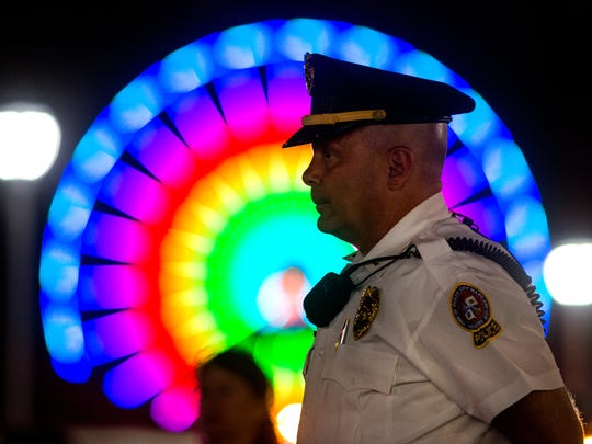 With the giant Ferris wheel at the Ocean City Inlet behind him, Lt. Mark Pacini of the Ocean City Police Department keeps a watchful eye on the Boardwalk.