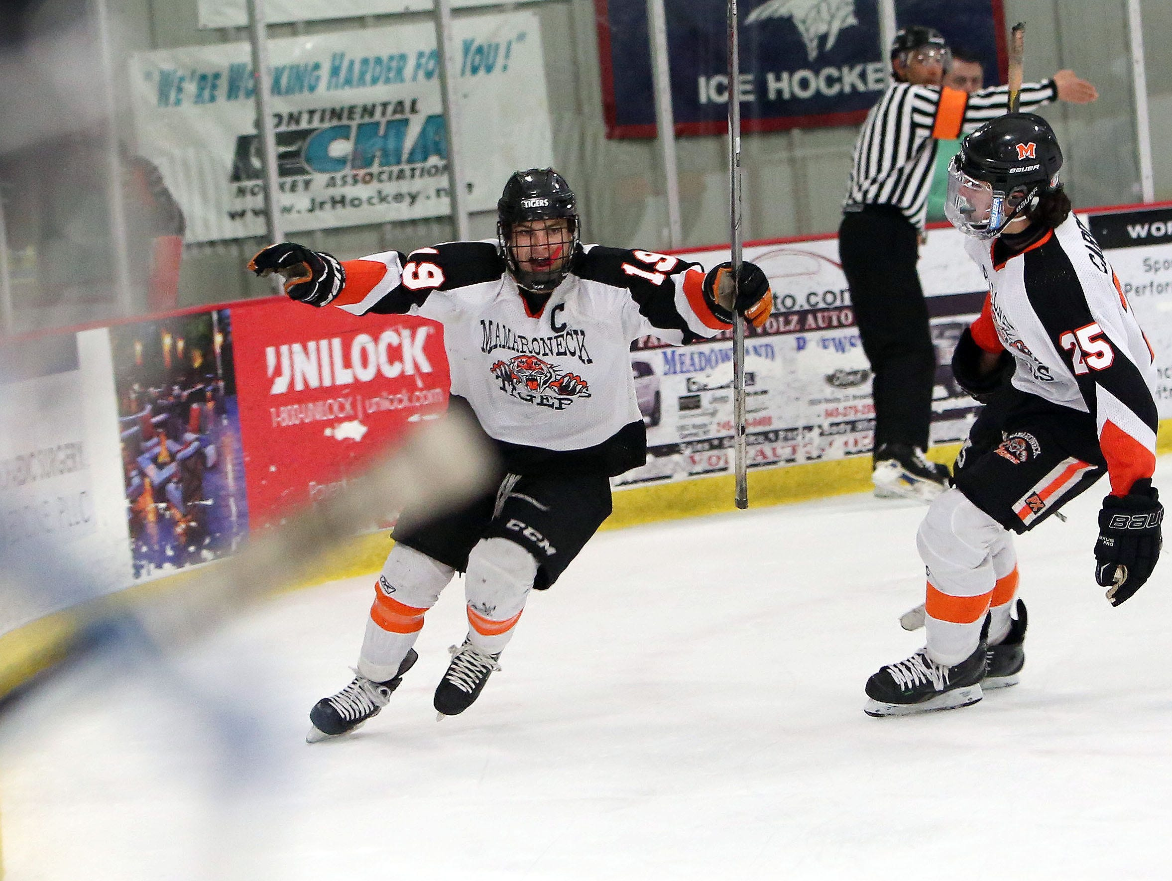 From left, Mamaroneck's Will Kirk (19) celebrates his third goal of the game against Suffern during the Section 1 championship hockey game at The Brewster Sports Arena Feb. 26, 2016. Mamaroneck won the game 5-1.