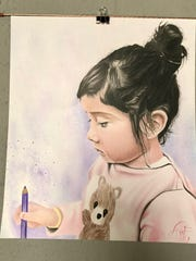 """This piece titled """"My Daughter"""" was created by Atruro Morales."""
