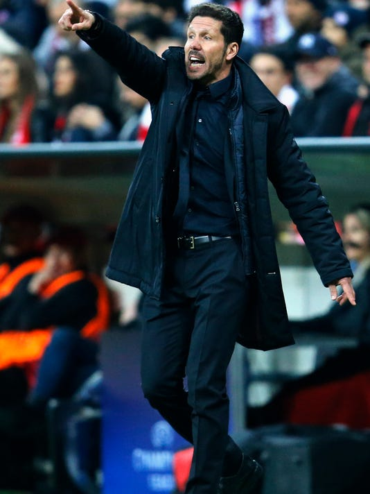 Atletico's coach Diego Simeone coaches his players during the Champions League second leg semifinal soccer match between Bayern Munich and Atletico de Madrid in Munich, Germany, Tuesday, May 3, 2016. (AP Photo/Michael Probst)
