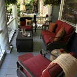 The front porch has a cozy seating area with lamp  that create an outdoor living space. June 11, 2015