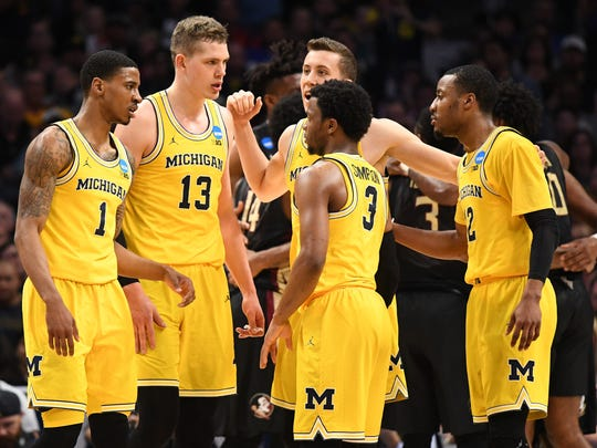 Michigan Wolverines guard Charles Matthews (1) and