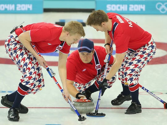 Team Norway competes in the Curling Men's Round Robin match between Norway and Germany during Sochi 2014 Winter Olympics.