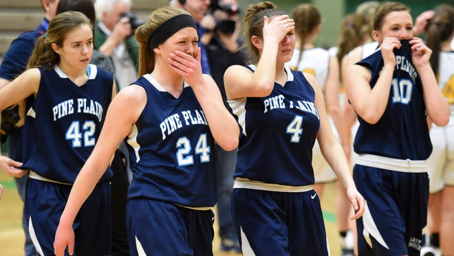 Pine Plains girls basketball team reacts to losing the Class C New York State Championship game versus South Seneca at Hudson Valley Community College in Troy on Sunday.