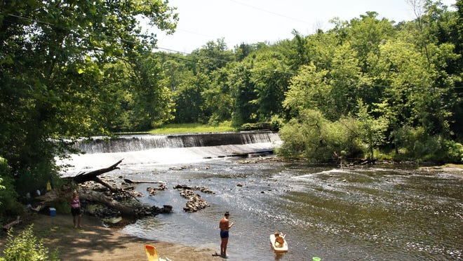 Downstream of the Paulina Dam on the Paulinskill is owned by Blairstown Township and has become an informal beach area as seen on Thursday, July 2, 2020.