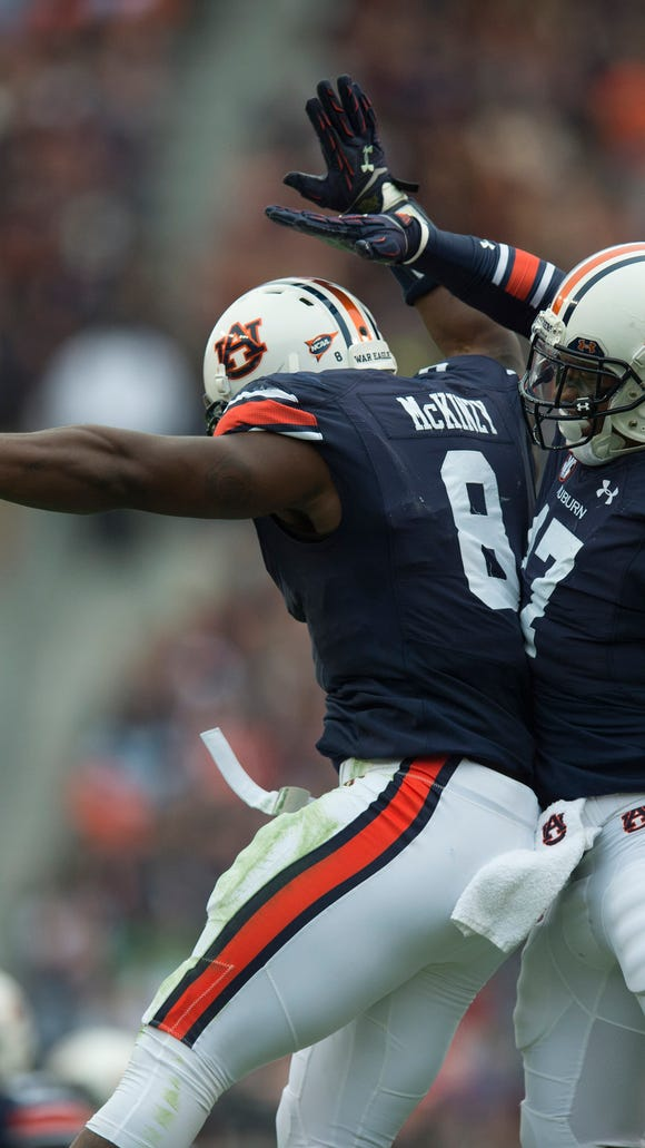 Auburn Tigers linebacker Cassanova McKinzy (8) celebrates with Auburn Tigers linebacker Kris Frost (17) after a sack during the NCAA football game between Auburn and Ole Miss on Saturday, Oct. 31, 2015, at Jordan-Hare Stadium in Auburn, Ala. Frost and McKinzy are two of Auburn's seniors that haven't won a bowl game in their career.