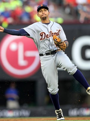 Tigers shortstop Dixon Machado makes an off-balance throw to first base during the third inning against the Texas Rangers on Aug. 13, 2016 at Globe Life Park in Arlington, Texas.