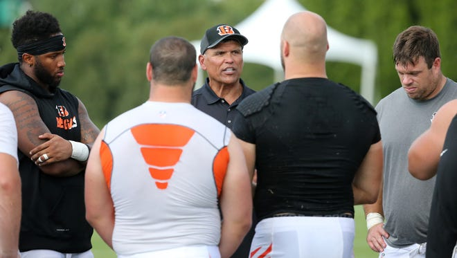 Former Cincinnati Bengals offensive lineman and Hall of Fame Anthony Munoz, center, addressed the offensive line during training camp.