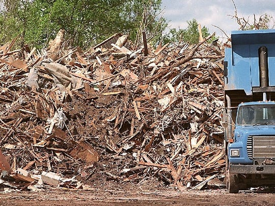 A truck unloads more rubbish onto the growing mountain