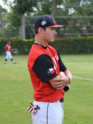 Texas Stix outfielder/pitcher Phil Sikes observes warm ups in Saturday's CMWS pool play game against D-BAT 18. Sikes hopes experience playing in Farmington will help him be ready for college baseball career at University of New Mexico.
