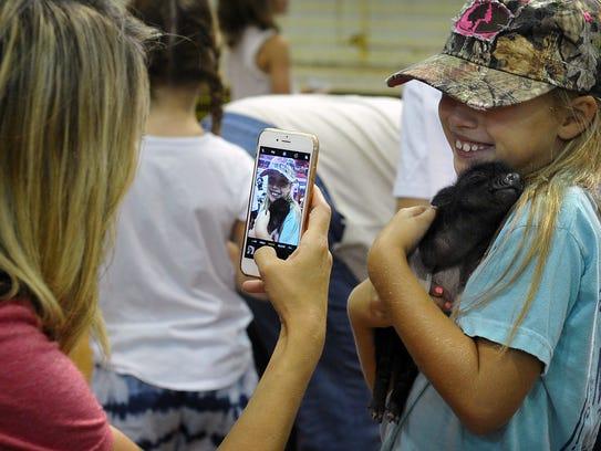 Crystal Johnson photographs her daughter, Savannah