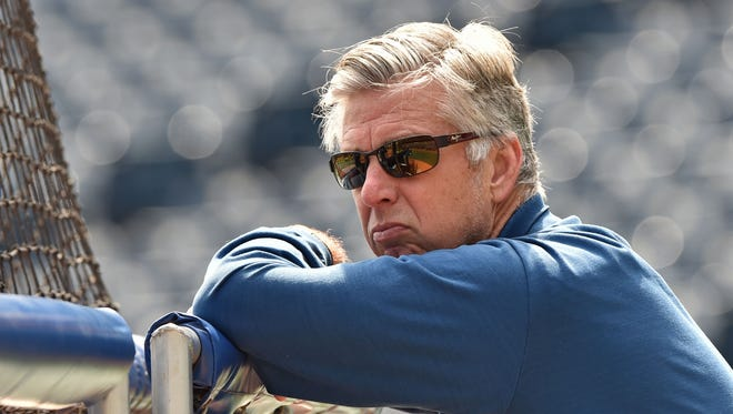 Dave Dombrowski watches batting practice prior to a game against the Kansas City Royals at Kauffman Stadium.