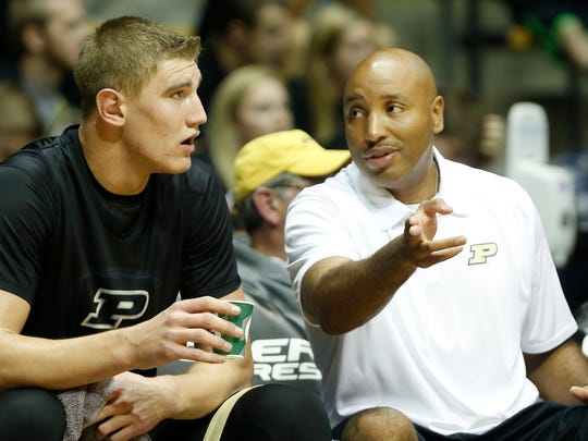 Assistant coach Brandon Brantley with instructions for Isaac Haas as Purdue men's basketball holds its second scrimmage Saturday, October 25, 2014, in Mackey Arena.