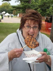 Locally sourced foods from pork to cream puffs and cranberries are a hit at festivals and fairs throughout Wisconsin.