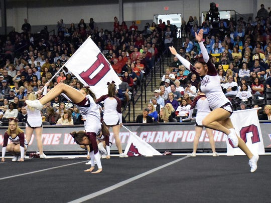 Stuarts Draft's competition cheer team performs during