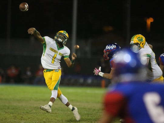 Coachella Valley quarterback Armando Deniz throws a pass to Jeremiah Perez on Friday, September 15, 2017 in Indio, during the annual bell game.