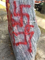 """Swastikas, """"Trump rules"""" and """"antifa sucks"""" were found Sept. 20 spray-painted on a monument next to the Gates of Heaven Synagogue in Madison."""