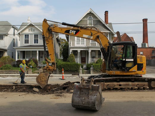 New Albany's Main Street is closed from East Fifth Street to Vincennes Street as work crews finish sidewalks and install medians that will eventually have landscaping as well as trees. The work is scheduled to be completed Sept. 26. Aug. 5, 2014 By Matt Stone/The Courier-Journal