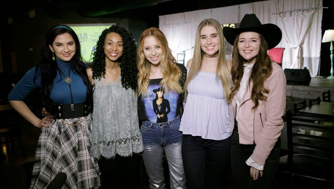 "In this Jan. 29, 2018 photo provided by Song Suffragettes, Inc., members of the Song Suffragettes, from left, Candi Carpenter, Tiera Leftwich, Kalie Shorr, Chloe Gilligan and Jenna Paulette pose for a photo in Nashville, Tenn. Female musicians in Nashville have long complained about the lack of representation on country radio, but now a collective of female songwriters are singing ""Time's Up."" Nearly two dozen women, all belonging to the Song Suffragettes collective, sang on the ""Time's Up"" song and music video released earlier this month. Quinton Cook/Song Suffragettes, Inc. via AP)"