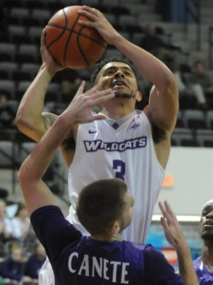 ACU's Tevin Foster (3) drives to the basket as Stephen F. Austin's Ivan Canete (11) defends. SFA beat the Wildcats 76-66 in the Southland Conference men's basketball game Wednesday, Jan. 17, 2018 at Moody Coliseum.