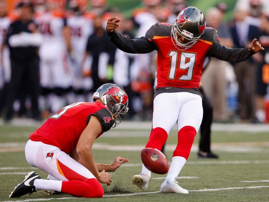 Tampa Bay Buccaneers' Roberto Aguayo (19) kicks a field goal from the hold of Bryan Anger (9) during the first half of the team's preseason NFL football game against the Cincinnati Bengals, Friday, Aug. 11, 2017, in Cincinnati. (AP Photo/Gary Landers)