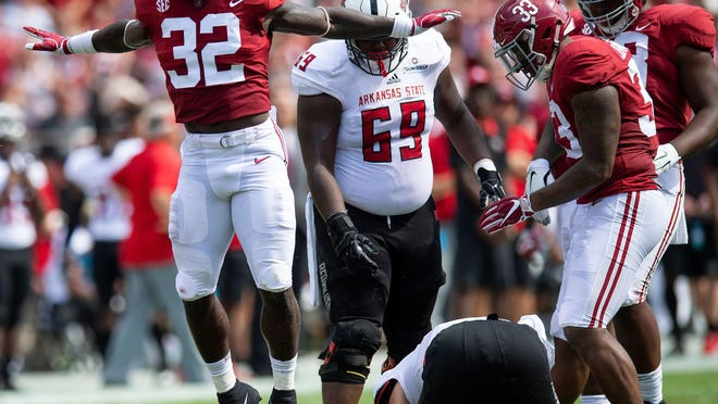 Alabama linebacker Dylan Moses celebrates a sack of Arkansas State quarterback Justice Hansen during their 2018 game. Moses, who was a Butkus Award finalist as a sophomore that year, was lost for the 2019 season just days before the Crimson Tide's opener.